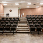 Small lecture hall featuring new seating and improve ADA accessible space