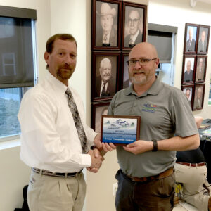 Greg Cash (left) receives the 2018 Outstanding Postsecondary Program Award for Colorado Agricultural Education from past CVATA President Troy Mayfield.